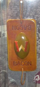 The Slab of Bacon, the former trophy given to the victor of the Wisconsin-Minnesota football game, after being lost for over 50 years, was found in a storage closet at Camp Randall Stadium. It now displayed at the Camp Randall Stadium Football Offices. Photo courtesy of user Gopherbone on Wikimedia Commons.