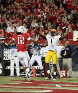 Arizona State wide receive Mike Willie celebrates in front of Arizona safety Adam Hall after catching a touchdown pass from Arizona State quarterback Brock Osweiler at Arizona Stadium in Tucson, Ariz., in 2010. Arizona State would go on to win the game 30-29 in double overtime. Photo courtesy of Scott Jones on Flickr.